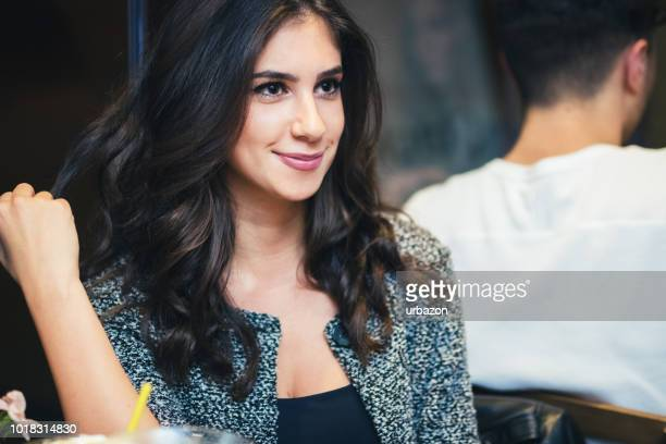 portrait of a young beautiful girl in a cafe. - cleavage stock pictures, royalty-free photos & images