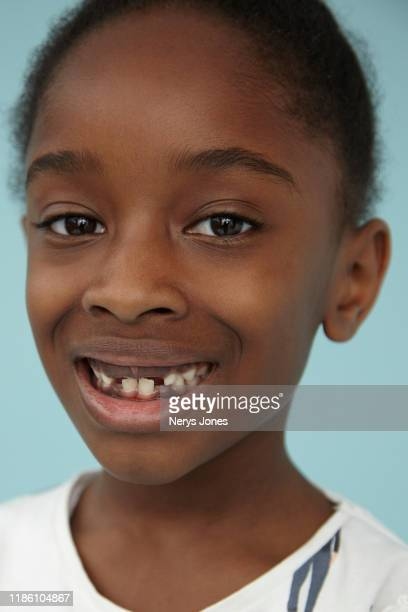 portrait of a young black girl - nerys jones stock photos and pictures