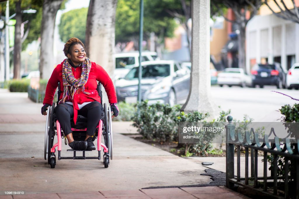 Portrait of a Young Black Woman in a Wheelchair : Stock Photo