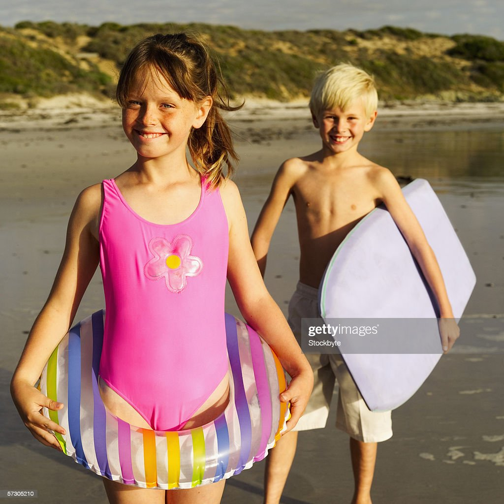 img chili nudistas Portrait of a young boy and a young girl (7-9) with beach gear. License  this image