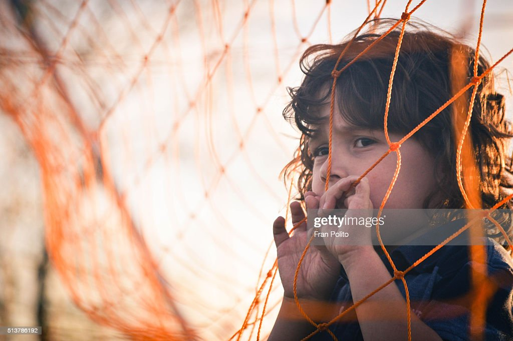 Portrait of a young boy at the park. : Stock Photo