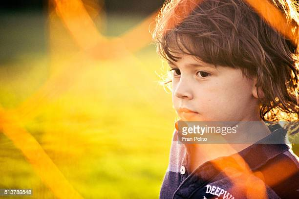 Portrait of a young boy at the park.