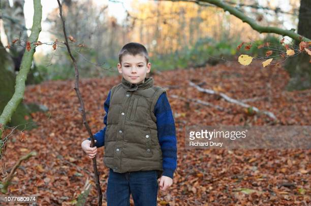 Portrait of a young boy in Autumnal woodland