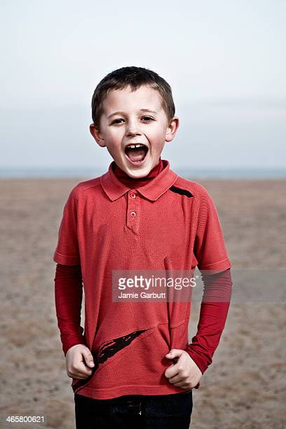 Portrait of a young boy screaming in excitement