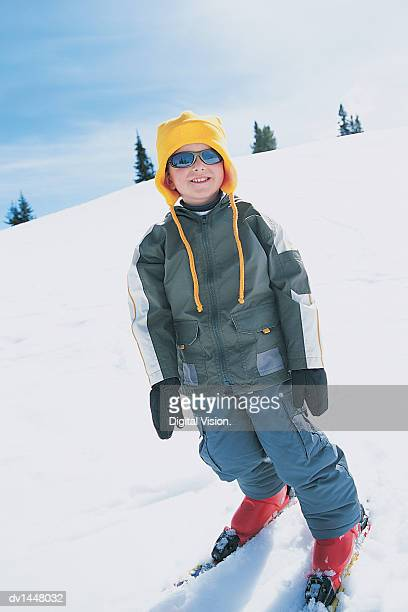 portrait of a young boy standing on a ski slope wearing skis - ski wear stock pictures, royalty-free photos & images
