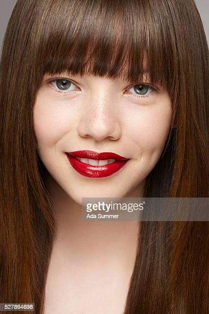 portrait of a young brunette with red lipstick