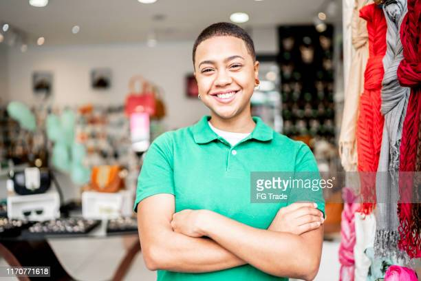 portrait of a young business owner standing with arms crossed in her store - pardo brazilian stock pictures, royalty-free photos & images