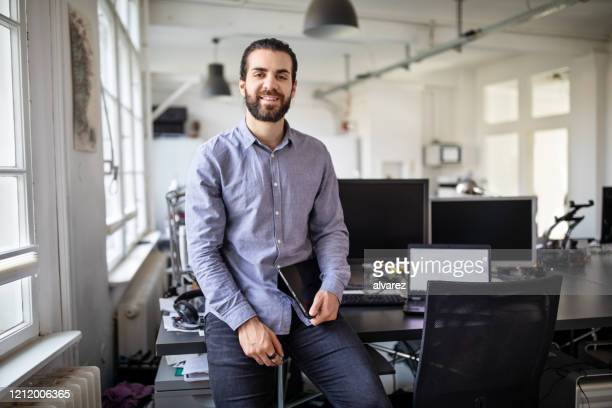 portrait of a young business professional at office - southern european descent stock pictures, royalty-free photos & images