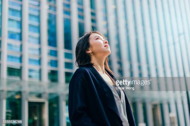 portrait of a young business woman determined to success - japanese ethnicity stock pictures, royalty-free photos & images