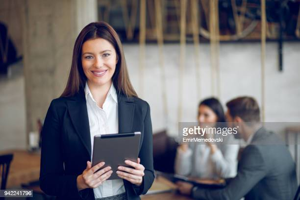 Portrait of a young business woman using digital tablet