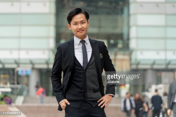 Portrait of a young businessman outdoors