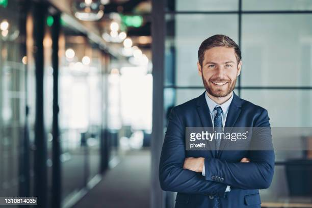 portrait of a young businessman - mid adult men stock pictures, royalty-free photos & images