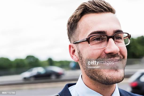 portrait of a young businessman - blonde glasses stock-fotos und bilder