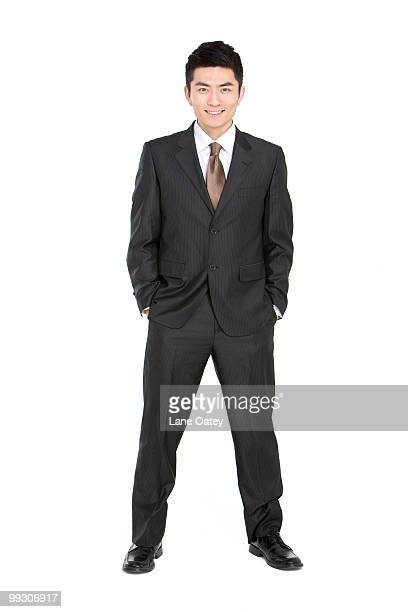 portrait of a young businessman - legs apart stock pictures, royalty-free photos & images