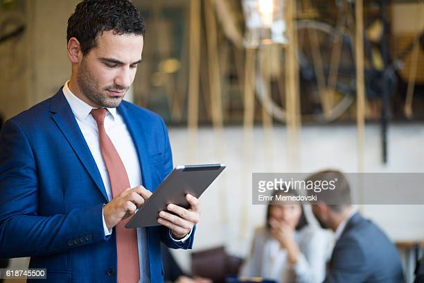 Portrait of a young businessman using digital tablet