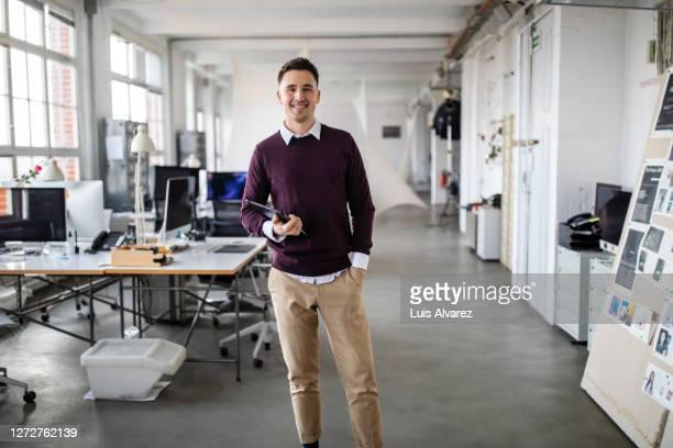 portrait of a young businessman with digital tablet - standing stock pictures, royalty-free photos & images