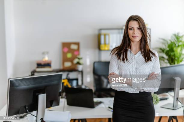 portrait of a young businesswoman in her office - assistant stock pictures, royalty-free photos & images