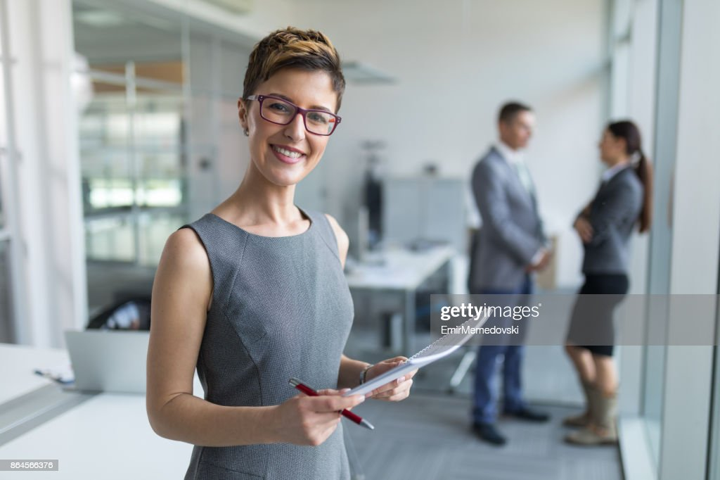 Portrait of a young businesswoman in the office : Stock Photo