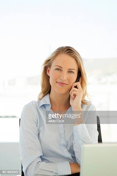 Portrait of a young businesswoman on the phone