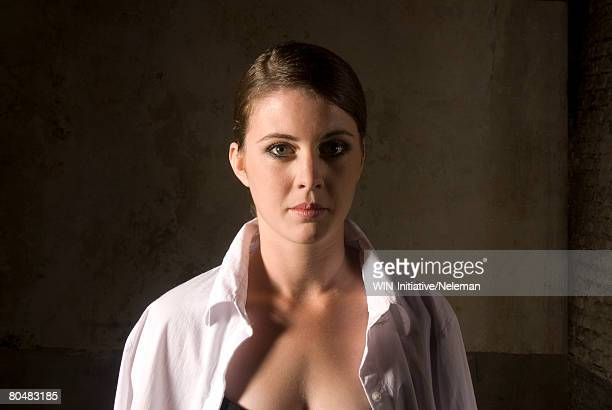 portrait of a young businesswoman  - fully unbuttoned stock pictures, royalty-free photos & images