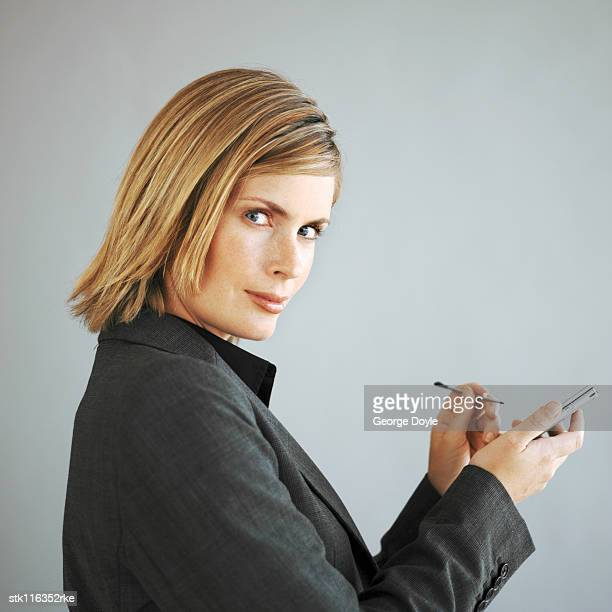 portrait of a young businesswoman using a handheld device