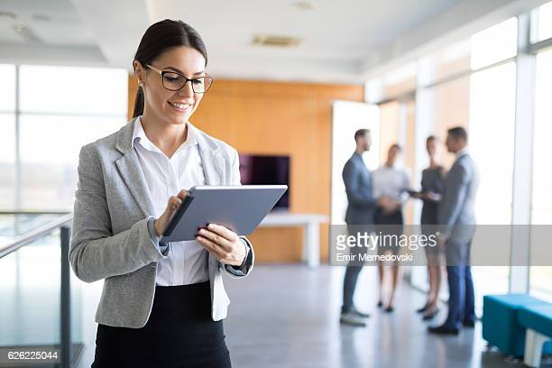 Portrait of a young businesswoman using  digital tablet.