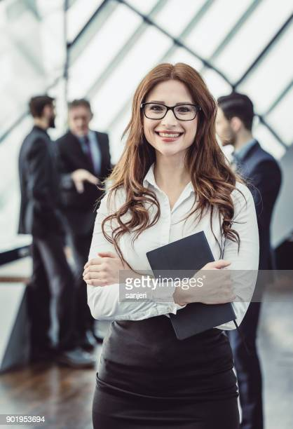 Portrait of a Young Businesswoman With Colleagues Behind