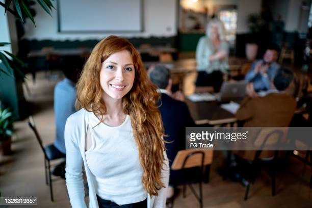 portrait of a young businesswoman with coworkers on the background - founder stock pictures, royalty-free photos & images