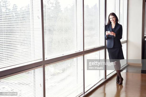portrait of a young caucasian woman in an office. - building atrium stock pictures, royalty-free photos & images