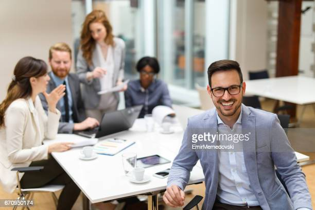 Portrait of a young cheerful businessman at the office