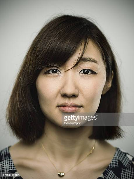 Portrait of a young chinese woman looking at camera