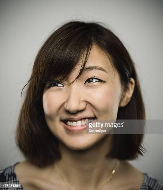のポートレート、若い中国人女性の幸せな笑顔