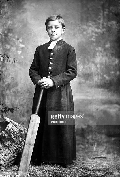 A portrait of a young choirboy who poses with his cricket bat for photographed by Henry Mayson at his Keswick Lake District studio in the late 19th...