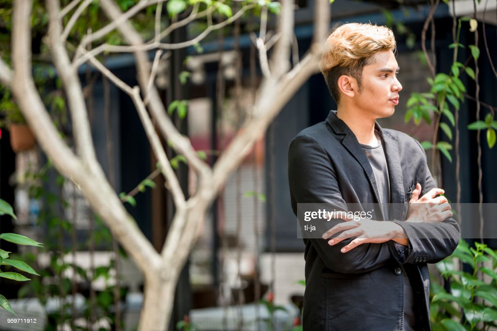 Portrait of a young confident man : Stock Photo