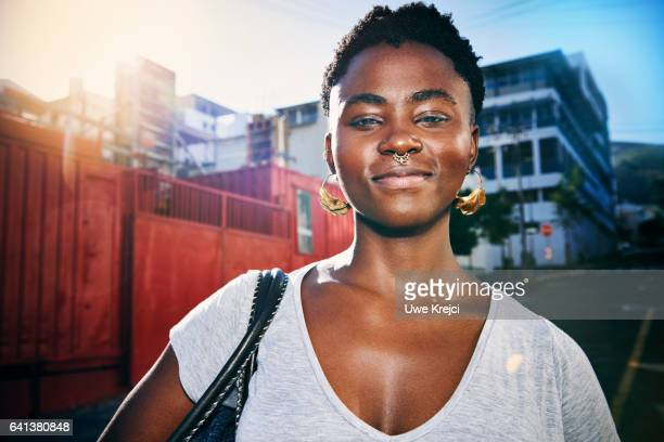 Portrait of a young confident woman in the city