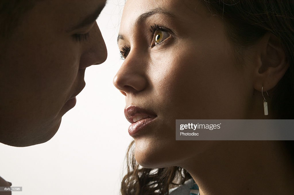 portrait of a young couple as they lovingly embrace and are about to kiss : Foto stock