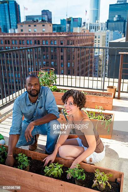 Portrait of a young couple gardening together