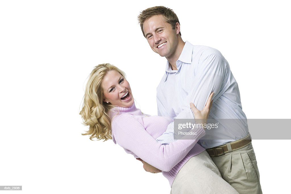 Portrait of a young couple holding each other : Foto de stock