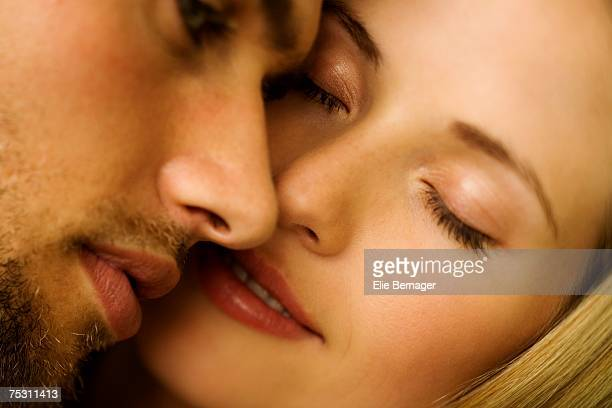 Portrait of a young couple in love, eyes closed