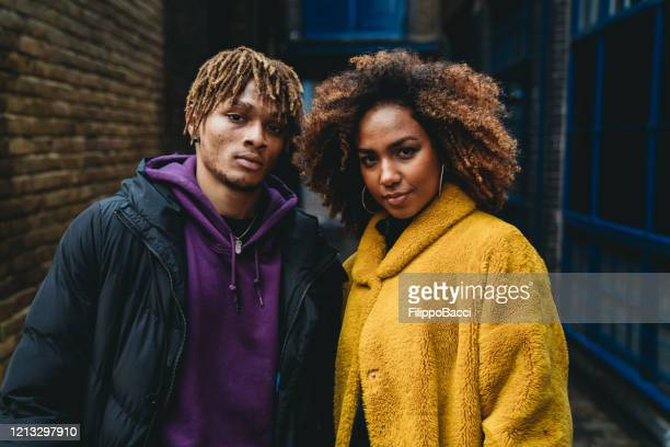 portrait of a young couple in the street - city life stock pictures, royalty-free photos & images