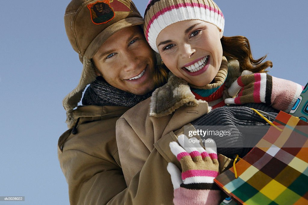 Portrait of a Young Couple in Winter Clothing Embracing : Stock Photo