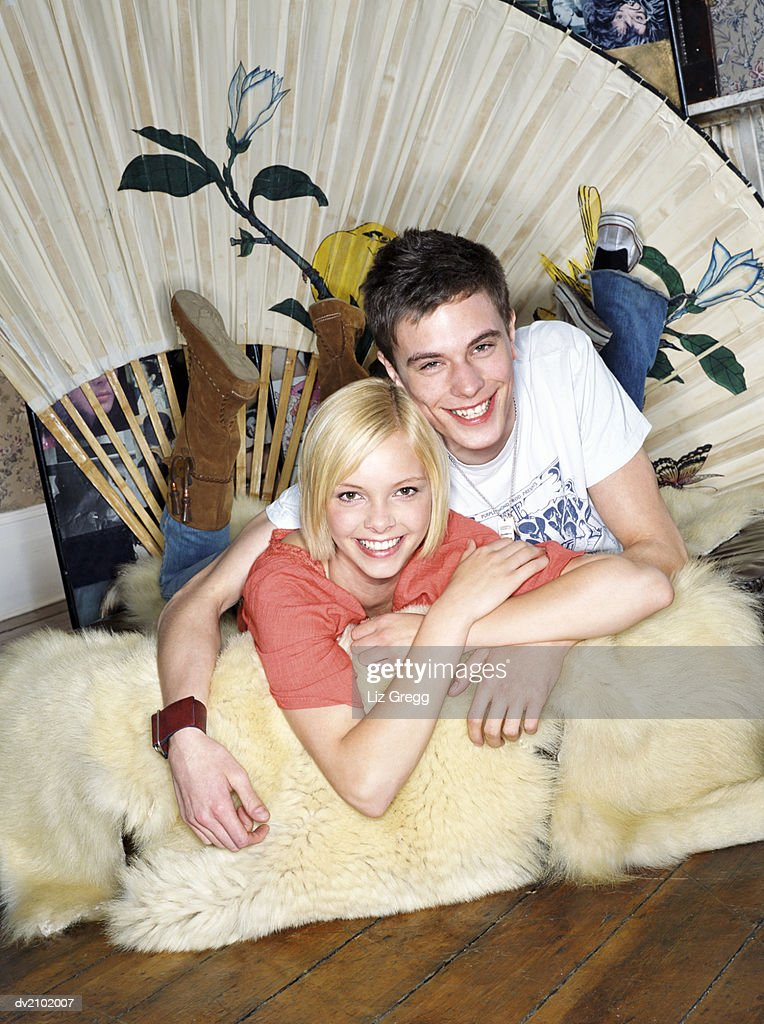 Portrait of a Young Couple Lying on a Fur Rug : Stock Photo