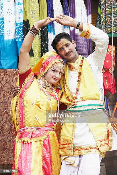 portrait of a young couple performing raasleela - radha krishna stock pictures, royalty-free photos & images