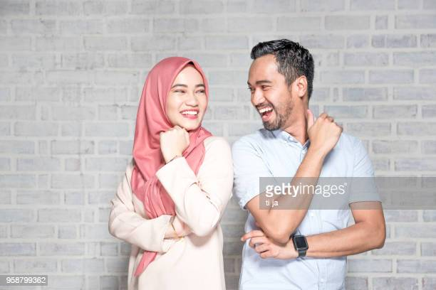 portrait of a young couple - islam stock pictures, royalty-free photos & images