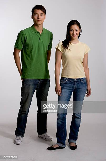 Portrait of a young couple standing side by side