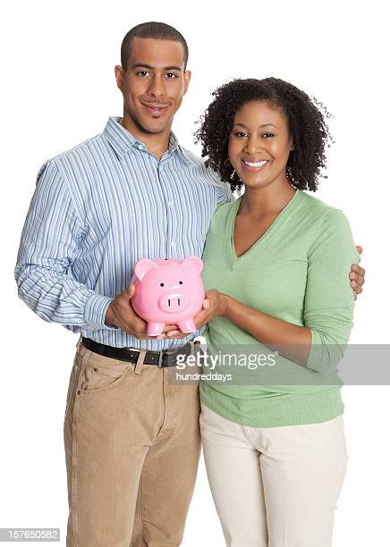 Portrait of a young couple with pink piggy bank