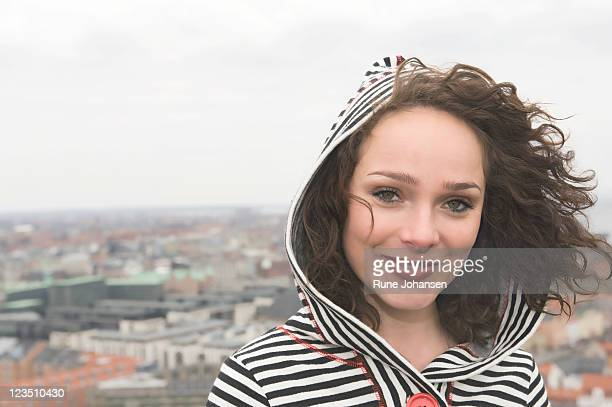 portrait of a young danish woman, 26 years old, outdoors in a black and white striped hooded sweater, copenhagen, denmark - oresund region stock photos and pictures