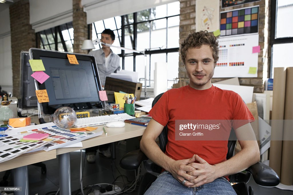 Portrait of a young designer in his office : Stock Photo