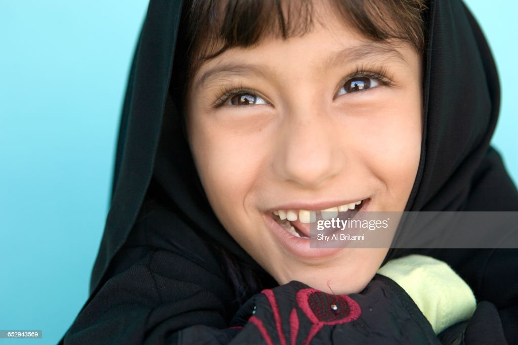 Portrait Of Young Girl In Front Of Suburban Home High-Res