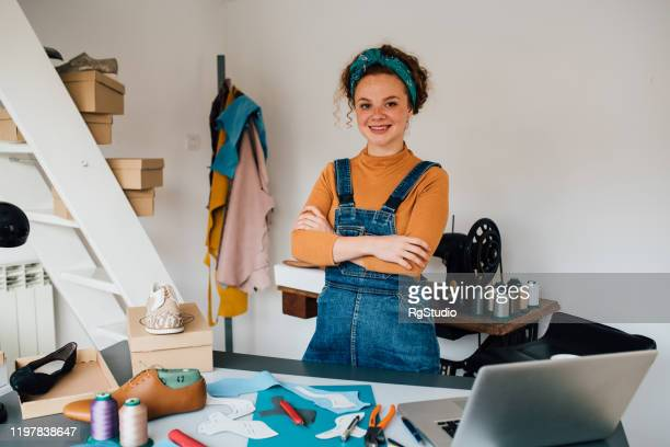 portrait of a young entrepreneur at her shoe workshop - leather shoe stock pictures, royalty-free photos & images